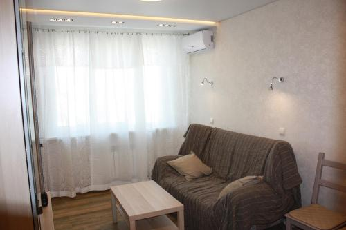 A seating area at Apartment on Lenina 146