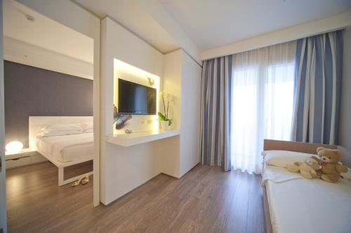 A bed or beds in a room at Oxygen Lifestyle Hotel/Helvetia Parco