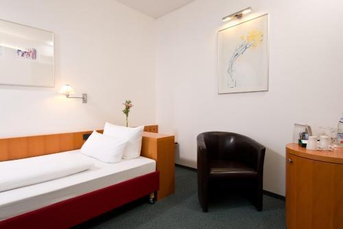 Ein Sitzbereich in der Unterkunft Hotel am Borsigturm