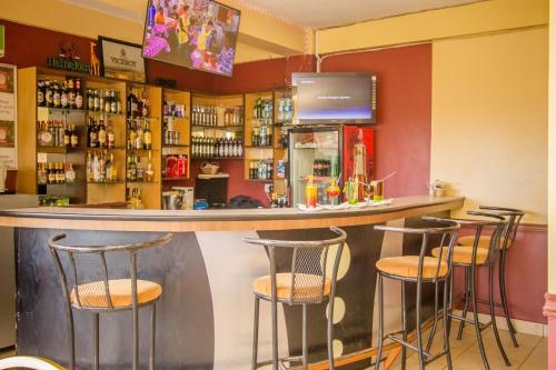 The lounge or bar area at Eland Safari Hotel Nyeri