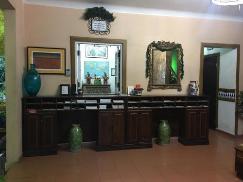 The lobby or reception area at Hotel Iberia - San Juan