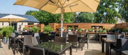 A restaurant or other place to eat at voco - Oxford Spires, an IHG Hotel