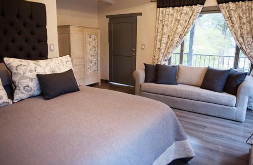 Cama o camas de una habitación en Hotel MasClara