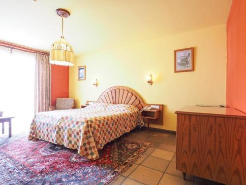 Een bed of bedden in een kamer bij Hotel La Palma Romántica