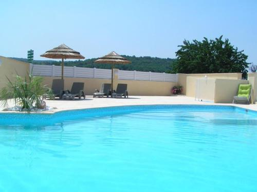 The swimming pool at or near Aux Couleurs D'Ardèche