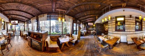 A restaurant or other place to eat at Momini Dvori Boutique Guest House