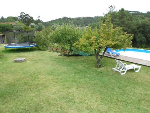 A view of the pool at Casa da Costureira or nearby