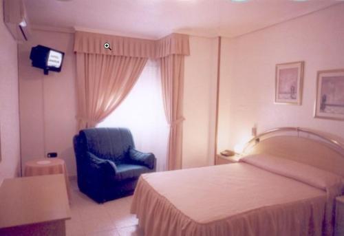 Кровать или кровати в номере Hotel Restaurante Santos