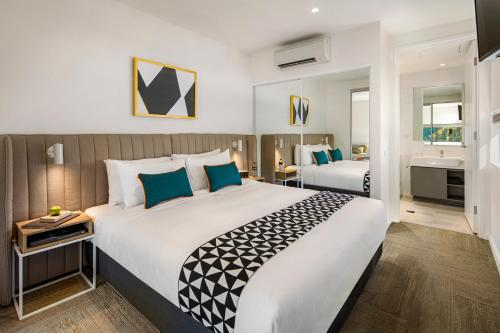 A bed or beds in a room at Quest Macquarie Park