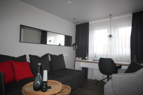 Ein Sitzbereich in der Unterkunft Hotel Restaurant Reichsadler