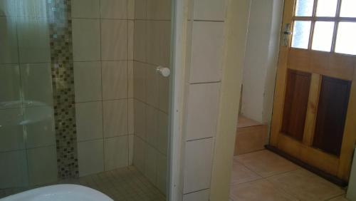 A bathroom at Grato Guesthouse