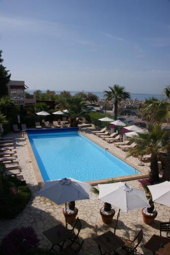 A view of the pool at Hôtel Azur Bord De Mer or nearby