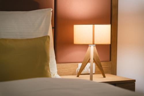 Posteľ alebo postele v izbe v ubytovaní Village Resort Hanuliak