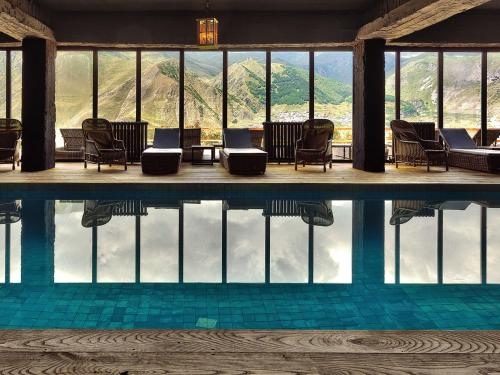 The swimming pool at or near Rooms Hotel Kazbegi