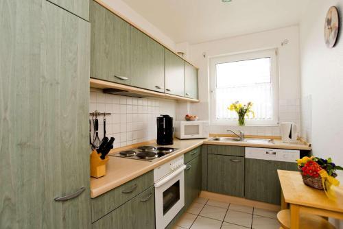 Küche/Küchenzeile in der Unterkunft Deich-Residenz App. 1
