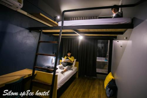 A bunk bed or bunk beds in a room at Silom Space Hostel
