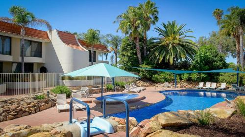 The swimming pool at or near Capri Waters Country Club