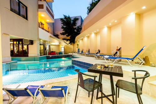 The swimming pool at or near Elina Hotel Apartments