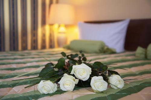 Кровать или кровати в номере Hotel Central Inn am Hauptbahnhof