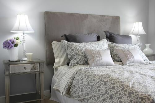 Łóżko lub łóżka w pokoju w obiekcie Triton Apartments in Warsaw near Airport