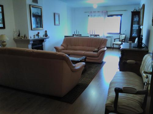 Uma área de estar em Chez Gorete by MP