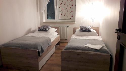 Кровать или кровати в номере Sonet Apartament