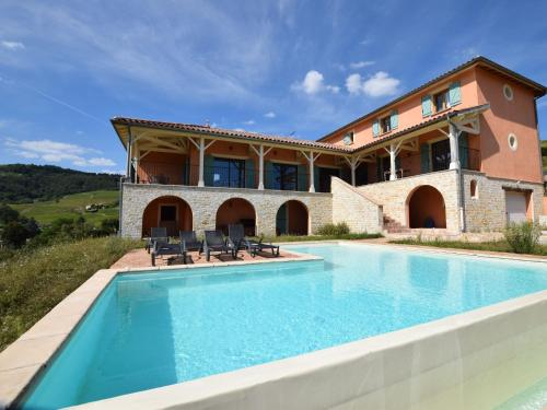 The swimming pool at or near Spacious Villa in Chiroubles with Swimming Pool