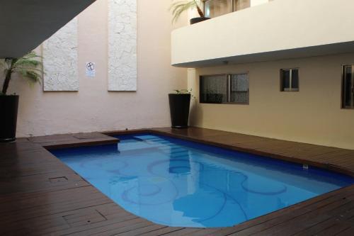 The swimming pool at or near Koox La Mar Condhotel