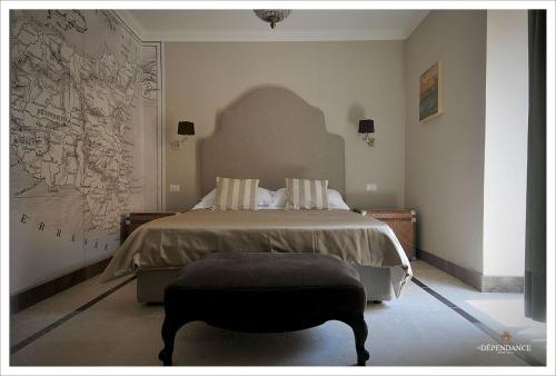 Letto o letti in una camera di La Dépendance Hotel