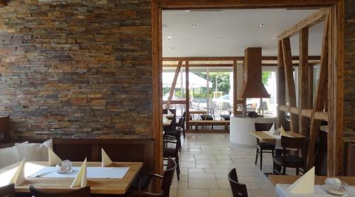 Ein Restaurant oder anderes Speiselokal in der Unterkunft Alte Schmiede