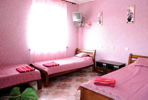 A bed or beds in a room at Motel Gostynets