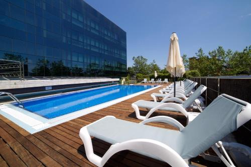 The swimming pool at or near Abba Playa Gijón