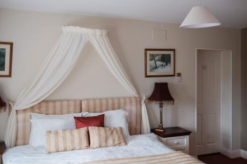 A bed or beds in a room at Newlands Country House