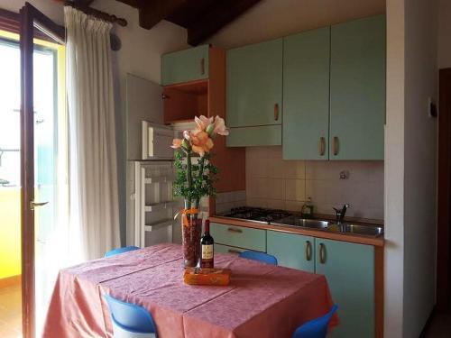 Kuchyň nebo kuchyňský kout v ubytování Villaggio Laguna