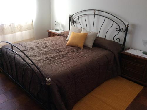 Letto o letti in una camera di Casa Pischinas