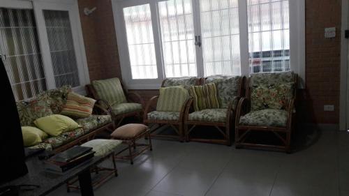 Uma área de estar em Casa Ampla Ubatuba