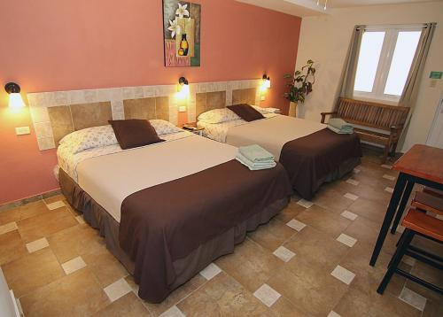 A bed or beds in a room at Dreams Hotel Puerto Rico