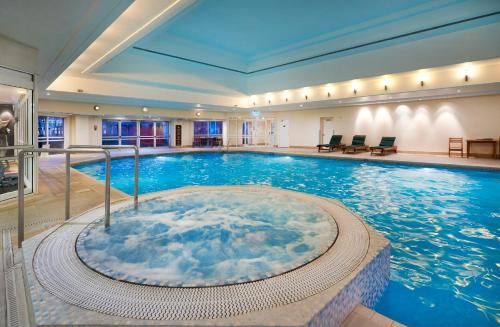 The swimming pool at or near Hilton Maidstone
