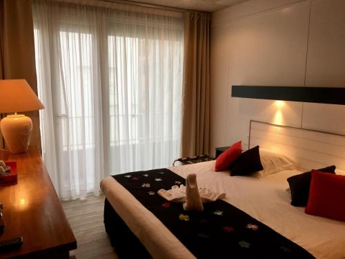 Un ou plusieurs lits dans un hébergement de l'établissement ROC Hôtel