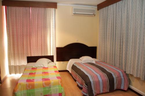 Uma cama ou camas num quarto em Residencial Bela Star