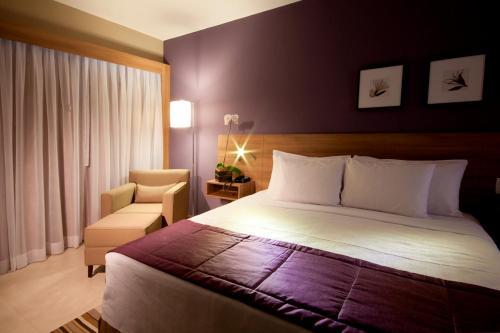 A bed or beds in a room at Comfort Hotel Sertãozinho