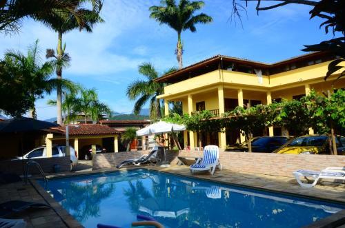 The swimming pool at or close to Pousada Sol Nascente