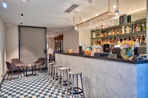 The lounge or bar area at La Falconeria Hotel