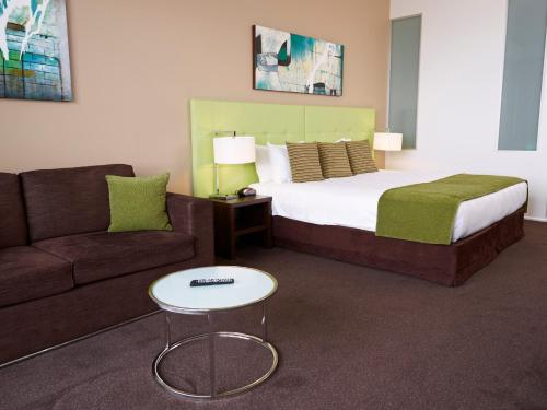 A bed or beds in a room at Mercure Melbourne Caroline Springs