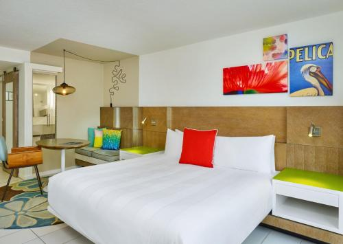 A bed or beds in a room at Royal Palm South Beach Miami, a Tribute Portfolio Resort