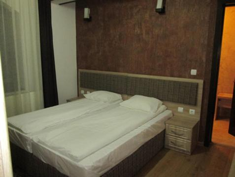 A bed or beds in a room at ,, La Moara ''