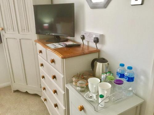 A television and/or entertainment center at Stepping Stones B&B