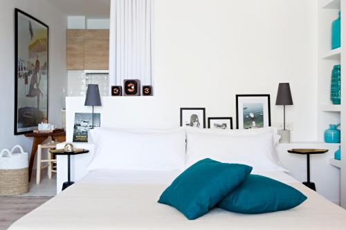 A bed or beds in a room at 105 Suites