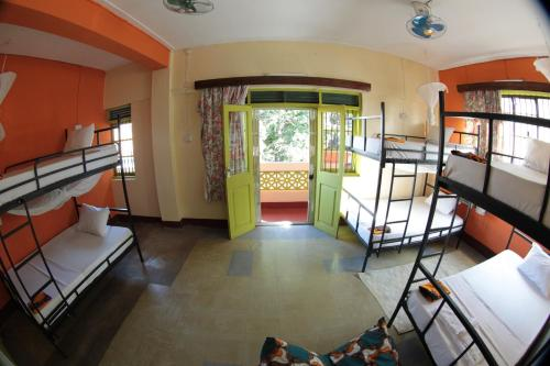 A bunk bed or bunk beds in a room at We Travel Hostel