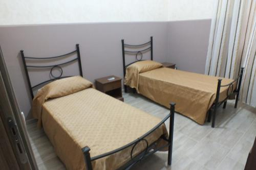 A bed or beds in a room at Casa Archimede